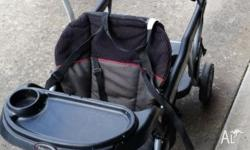 Well loved and used sit stand stroller. Awesome as a