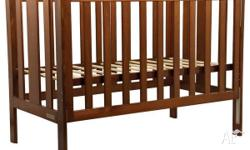 Solid timber cot with slat sides convenient drop side