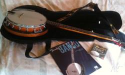 FB-­300. Includes, gig bag, strings, strap and