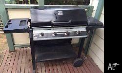 4 Burner BBQ with hot plate. Plenty of storage space,
