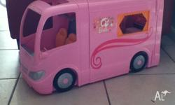 This Barbie camper van is perfect for any girl wanting