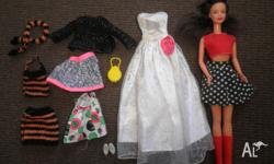 Barbie doll. Comes with assorted clothes, shoes and