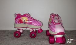 Size 1 barbie roller skates, only used once, look like