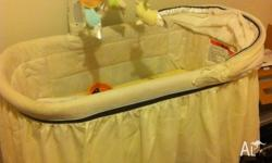 Almost new bassinet with mobile, music, light and