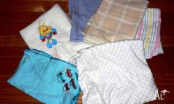 Linen/bedding for a baby's bassinet. Mixed selection.