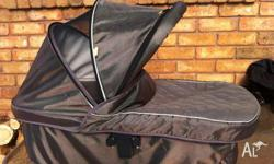 Bassinet to suit Strider DLX, toffee colour. $75 ono.