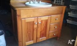 Free standing bathroom sink and vanity. Pine finish.