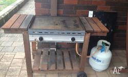 Cook on 2 burner BBQ. Average condition but works great