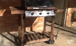 3 burner BBQ with hood suitable for baking a roast.