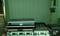 BBQ purchased from bbq galore. 4 burner, 1/2 hot plate
