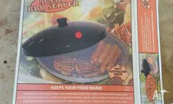 Aussie BBQ Server - Keeps food warm. Was a gift and