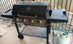 An old BBQ stove and a full gas bottle. The gas bottle
