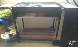 Used BBQ,has grill, dish and grid compartment. Has a