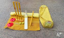 Beach cricket set including mat, wickets, bat, cones,