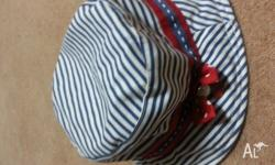 Beautiful cherry hat for sale (to fit 2-7 yrs). Never
