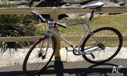 A beautiful white fixed gear bike for sale. In great