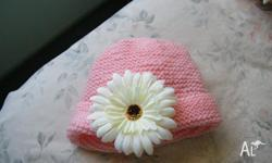 THESE BEAUTIFUL BEANIES HAVE A REMOVABLE FLOWER FOR