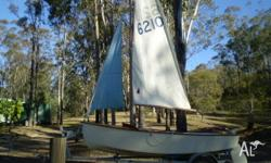 Beautiful wooden Heron sailing dinghy in excellent