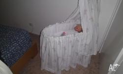 Beautifull Doll Cot,with doll, newly covered! Will look
