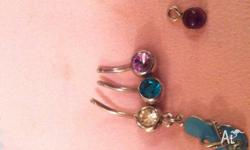 Silver belly button bars and a charm to hang on a ring