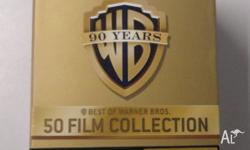 Good condition, in box. 50 Movies Including 16 of