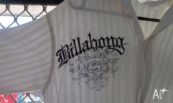 Used but clean short sleeve Billabong Shirt. Cool white