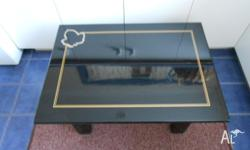 This is a small low Black Lacquered coffee table with a