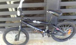 BMX BIKE - BRAND NAME/HUFFY & THE COLOUR BLACK WITH
