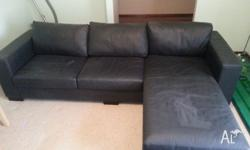 Black Leather Sofa with a side extension & excellent