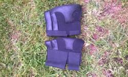 Black neoprene boots. Horse hock or fetlock boots? They