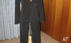 Quality Women's Black Suit Well tailored, low rise with