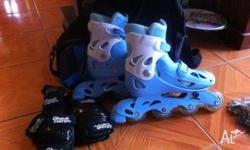 Junior Rollerblades blue and white. Adjustable - sizes