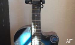 "This is a 3/4 size 38"" blue acoustic guitar made by"