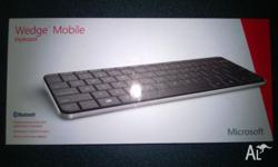 As new in box, includes tablet stand rrp $99, has