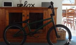 Green with black forks, rims and handle bars. leather