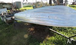 3.6m v bottom boat , motor and trailer unsure of hp of