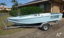 Timber boat with running lights and some safety gear on