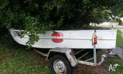 Aluminum dinghy is in fair condition and the trailer is