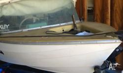 Neat first boat with trailer and evinrude motor. Rego