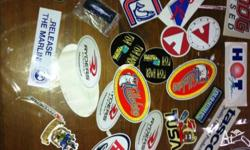 At least 35 stickers and badges relating to fishing