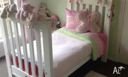 White BOORI cot which turns into a junior bed for sale.