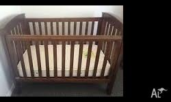 Walnut stained, wooden cot and change table, used