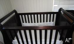 I'm selling my Walnut Boori sleigh cot, our baby days