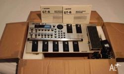 BOSS GT6 Multi-Effects Unit with power supply. Comes in