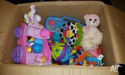 Large box full of assorted baby toys. In good