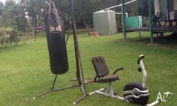 Very large and heavy boxing bag comes with stand and