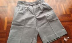 This grey school short is in great condition, in size