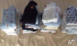 Approximately 25 winter onesies, boys size 00 and 1