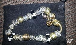 Pandora like bracelet with all the charms, brand new,