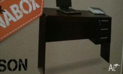 Brand new desk and office chair flat packed. Never used